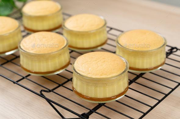 Caramel custard pudding cake in glass bowl - Stock Photo - Images