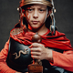 Boy in dark armour and red cape with sword in dark background - PhotoDune Item for Sale
