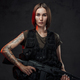 Tattoed martial woman in black armour with assault rifle - PhotoDune Item for Sale