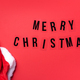 Bright red Santa Claus hat on red background. Top View. Copy space. Merry Christmas concept. Banner - PhotoDune Item for Sale