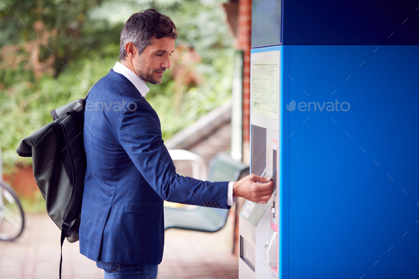 Businessman Commuting Making Contactless Payment For Train Ticket At Station Machine With Card - Stock Photo - Images
