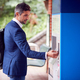 Businessman Commuting Making Contactless Payment For Train Ticket At Station Machine With Card - PhotoDune Item for Sale