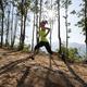 Fitness woman trail runner running on sunrise tropical forest mountain peak - PhotoDune Item for Sale