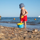 Boy kid in red shorts on the summer beach - PhotoDune Item for Sale