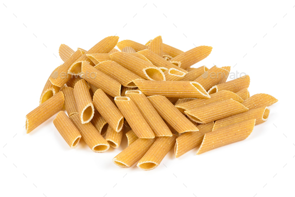 Heap of raw penne pasta on white background - Stock Photo - Images