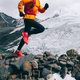 Woman trail runner cross country running up to winter snow mountain top - PhotoDune Item for Sale
