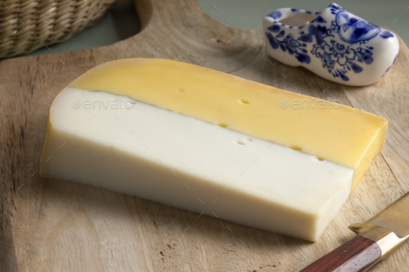 Double dutch cheese close up at a cutting board - Stock Photo - Images
