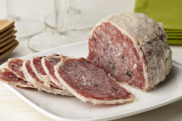 Saltufo sausage and slices on a dish close up - Stock Photo - Images