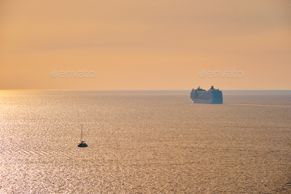 Cruise ship silhouette in Aegean sea on sunset - Stock Photo - Images