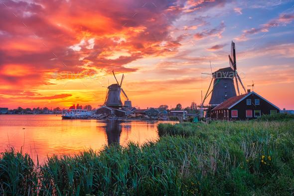 Windmills at Zaanse Schans in Holland on sunset. Zaandam, Nether - Stock Photo - Images