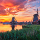 Windmills at Zaanse Schans in Holland on sunset. Zaandam, Nether - PhotoDune Item for Sale
