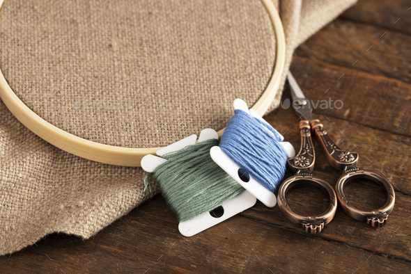 Embroidery Floss with Scissors and Linen - Stock Photo - Images