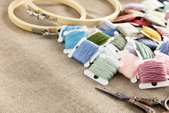 Embroidery Floss with Hoops and Scissors on Linen - Stock Photo - Images
