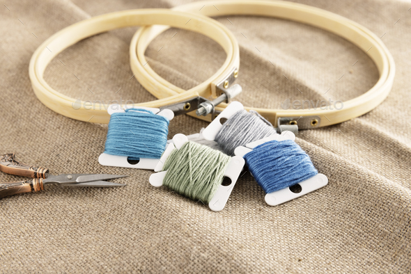 Embroidery Floss with Hoops on Linen - Stock Photo - Images