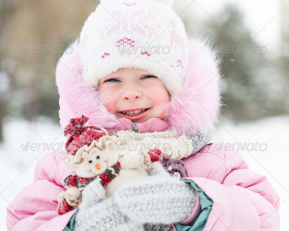 Child with snowman - Stock Photo - Images