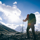 Strong woman backpacker hiking in winter mountains - PhotoDune Item for Sale