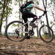 Woman cyclist cycling on mountain top forest trail - PhotoDune Item for Sale