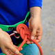 Rock climber wearing safety harness making a eight rope knot - PhotoDune Item for Sale