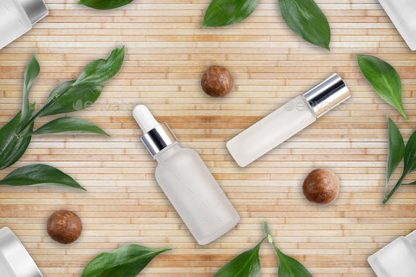 Tileable seamless flat lay background of bottles with macadamia nut cosmetics - Stock Photo - Images