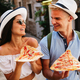 Group of friends eating pizza while traveling on vacation - PhotoDune Item for Sale
