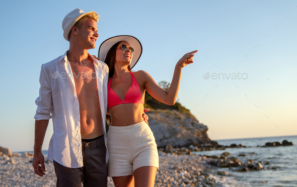 Happy honeymoon vacation. Young family, man and woman rest on the beach of ocean - Stock Photo - Images