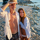 Attractive young couple on the beach, enjoying summer vacation, travel - PhotoDune Item for Sale