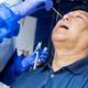 Mature asian man doing covid 19 PCR nasal swab test via nostril - PhotoDune Item for Sale