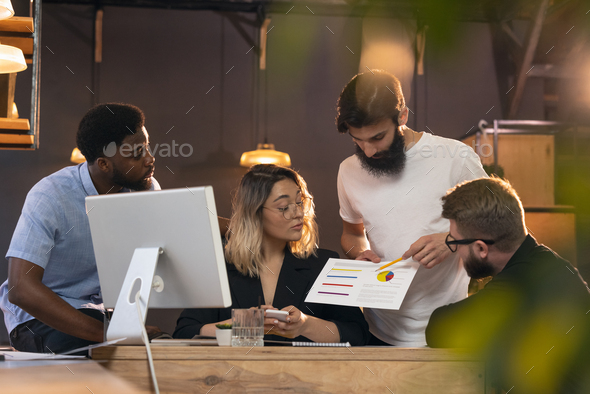 Colleagues working together in modern office using devices and gadgets during creative meeting - Stock Photo - Images