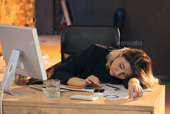 Businesswoman, manager working in modern office using devices and gadgets - Stock Photo - Images