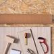 Laminate floor on osb wood background texture and tools. Wooden laminate floor - PhotoDune Item for Sale