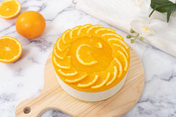 No baked orange cheese cake with fresh oranges decoration - Stock Photo - Images