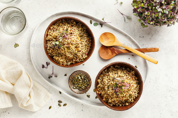 Healthy quinoa bowls with micro greens and pumpkin seeds - Stock Photo - Images