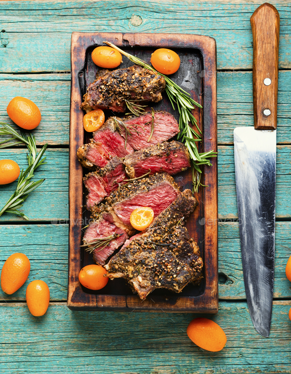 Juicy beef steak with kumquat,top view - Stock Photo - Images