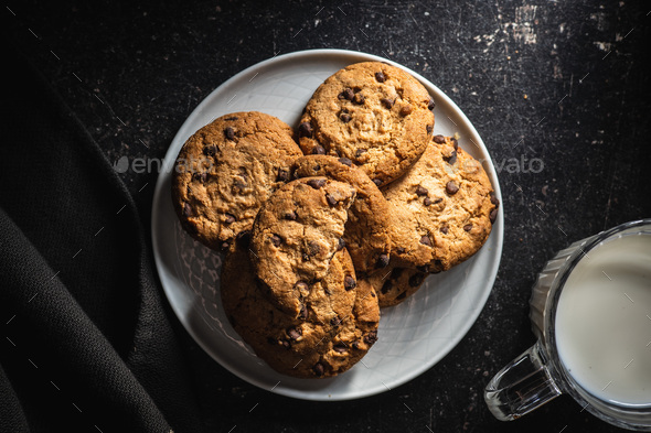 Tasty biscuits with chocolate. Sweet chocolate cookies on plate. - Stock Photo - Images