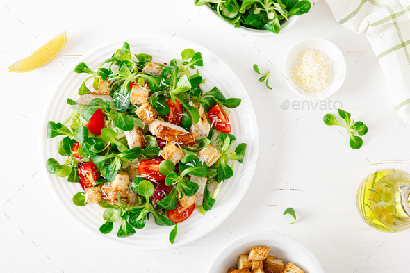 Caesar salad with grilled chicken meat - Stock Photo - Images