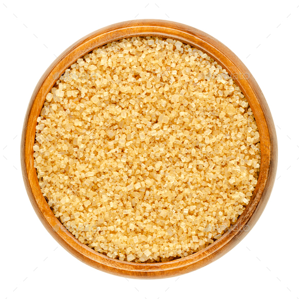 Coarse demerara sugar, crystalline raw sugar, in a wooden bowl - Stock Photo - Images