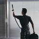Man cleaning dust from window blind by vacuum cleaner at home - PhotoDune Item for Sale