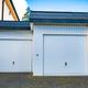 wide garage door and concrete driveway in front - PhotoDune Item for Sale