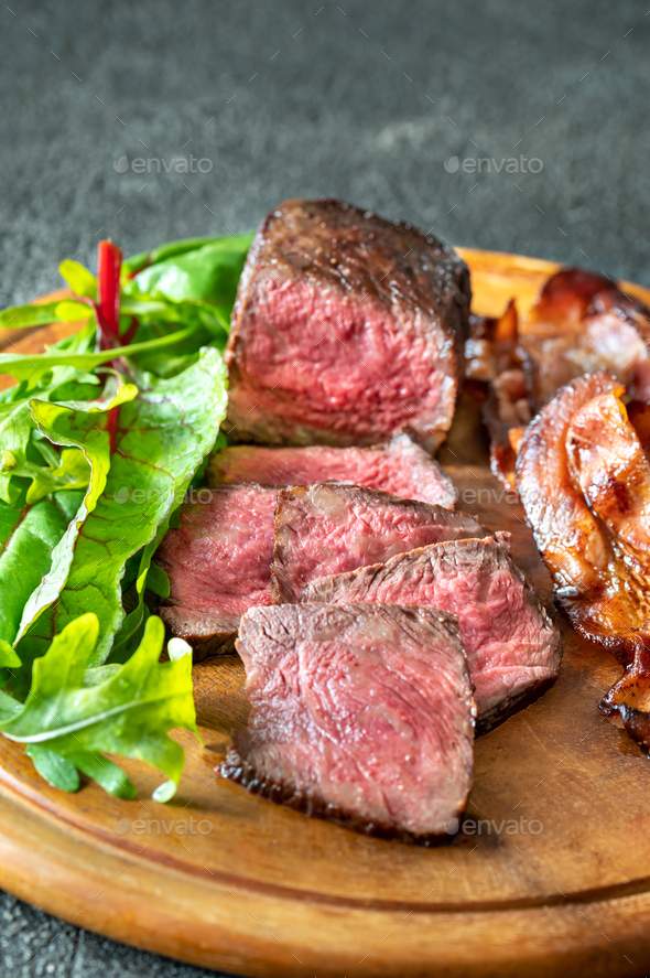 Beef steak with fried bacon - Stock Photo - Images