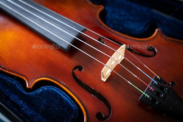 A close up of a syphony violin set against a black background - Stock Photo - Images