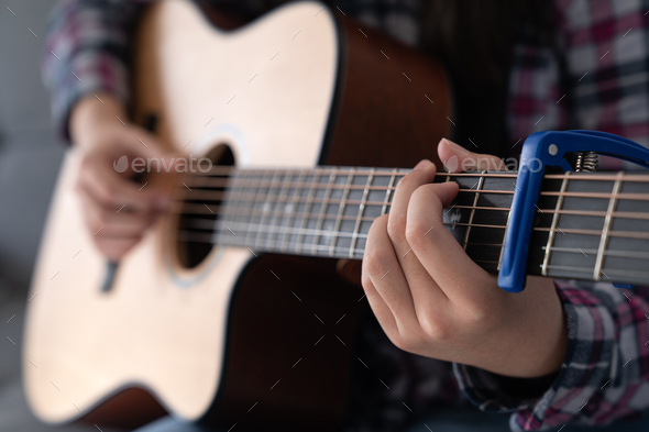Woman's hands playing acoustic guitar, close up - Stock Photo - Images