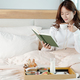 Woman spending morning in bed - PhotoDune Item for Sale
