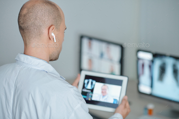 Doctor calling coworker - Stock Photo - Images
