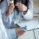 Doctors prescribing antidepressants to vaccinated patient - PhotoDune Item for Sale
