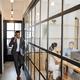 Entrepreneur walking along office corridor - PhotoDune Item for Sale