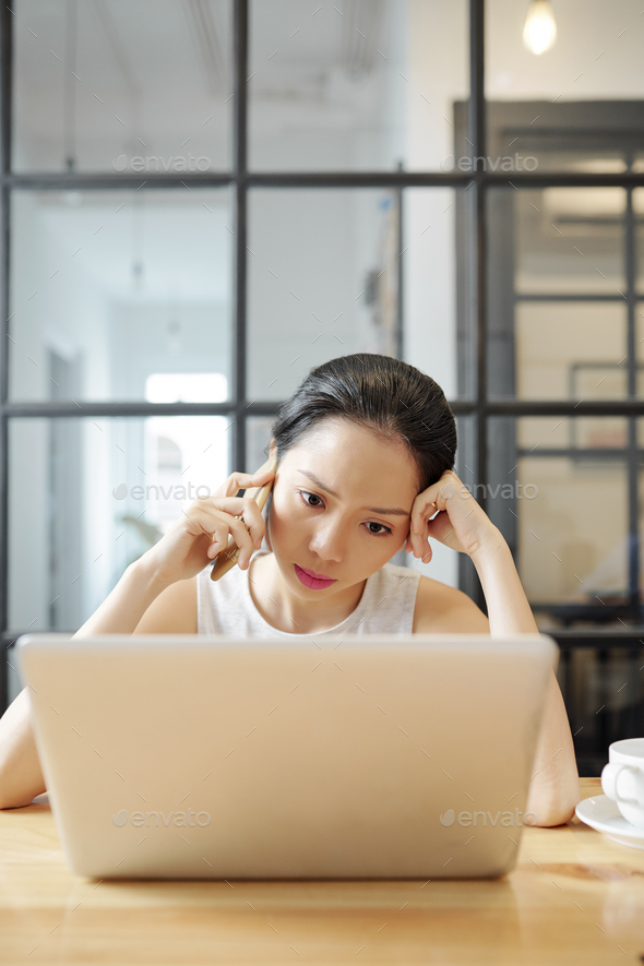 Seious entrepreneur making phone call - Stock Photo - Images