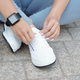 Sportswoman tying shoelaces - PhotoDune Item for Sale