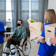 A person in a wheelchair talking to a group of young volunteers - PhotoDune Item for Sale