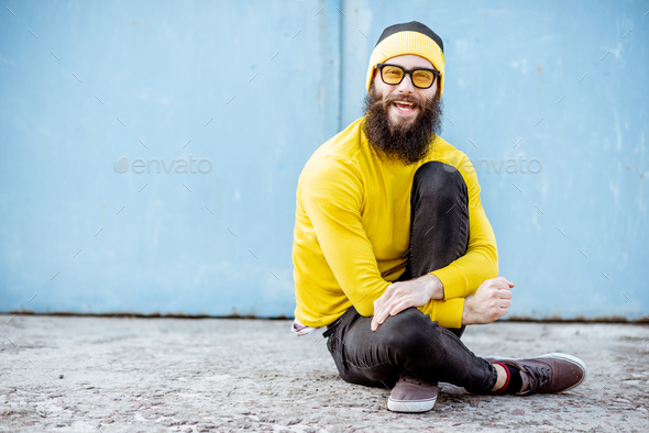 Portrait of a stylish man on the colorful background - Stock Photo - Images