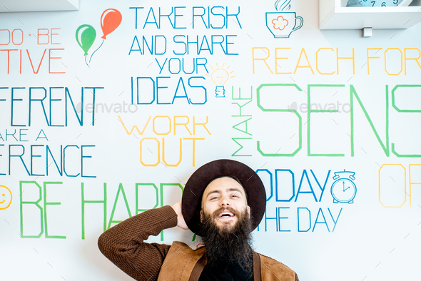 Man on the wall background with various inscriptions - Stock Photo - Images